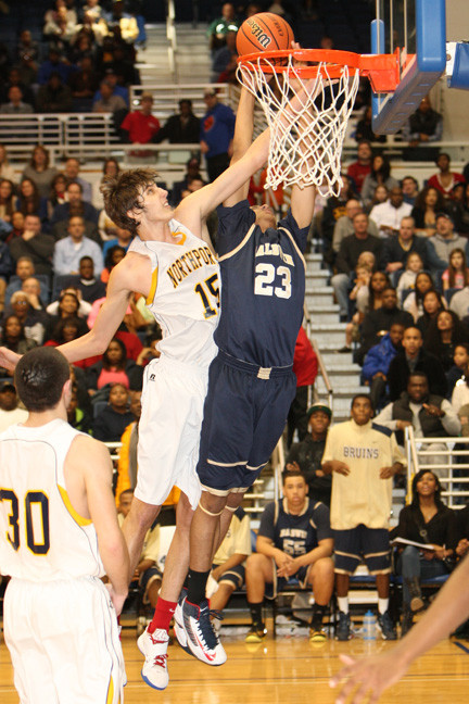 Baldwin's Eric Mack, right, soars over Northport's Luke Petrasek during the first half of last Saturday's Long Island Class AA title game.