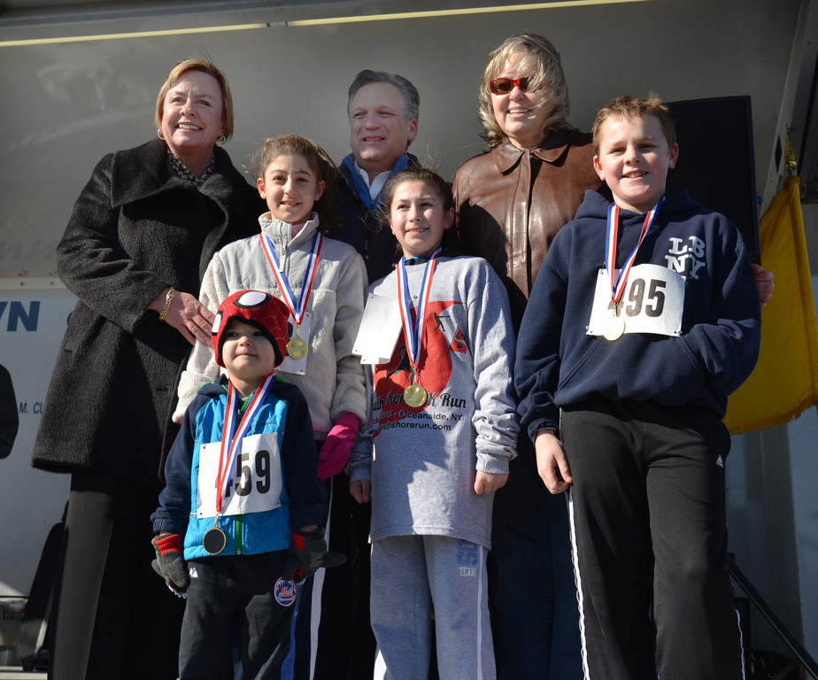 Kate Murray, Ed Mangano, Denise Ford, with winners of the kids race, Mia Judd 9, Hallie Neufeld 10, Nick Weisendanger 10, Ian Olivo 4 at the little league fundraiser in Oceanside Park last Saturday.