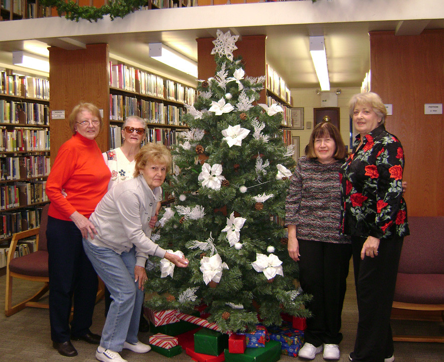 Despite Dwindling membership, members of the club have decorated the tree at the Waldinger Library every Christmas. Dorothy Walz, second from left, was the group�s final president.