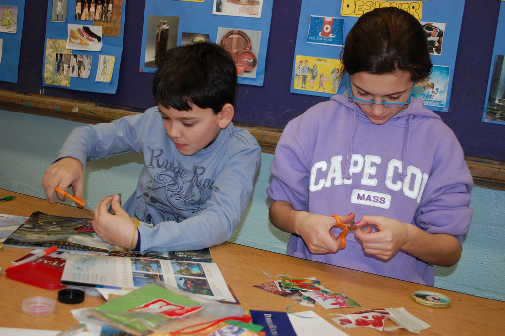 Joseph Evola and Jenna Zajac, fourth-graders at the James A. Dever School, made buttons last Saturday in the arts and crafts workshop, part of District 13�s SCOPE enrichment program.