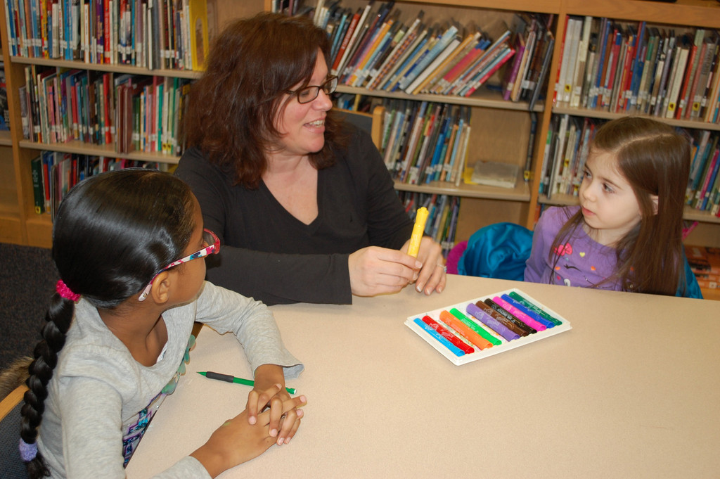 Spanish teacher Josephine Evola used markers to teach the students the names of colors.