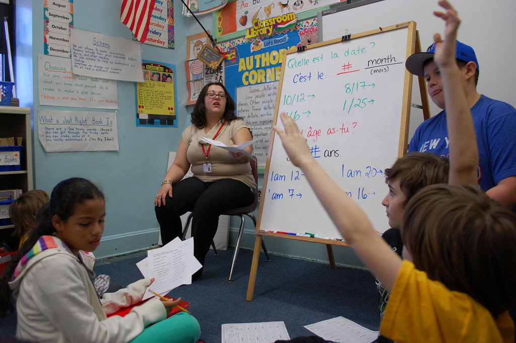 Allison Kaminsky, who works in the high school district, has been teaching French to students in grades K-6.