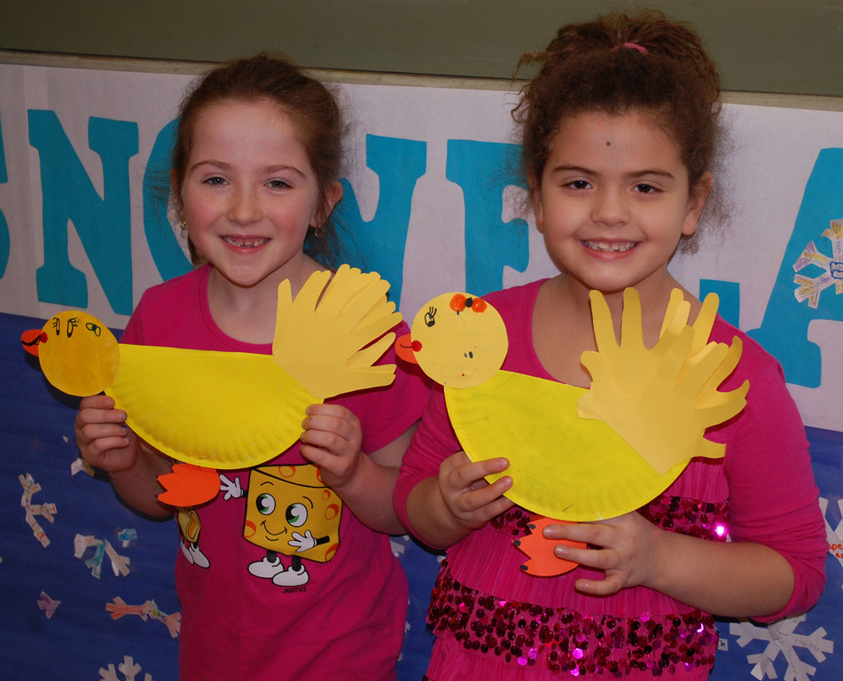 Second-graders Grace Mahoney and Adrianna Tumminello show off the crafts they made.