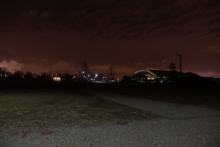 A nighttime shot of the Nassau County Aquatic Center, upper right, taken from the edge of Lot 1, the main overflow lot, showed a largely unlit path.