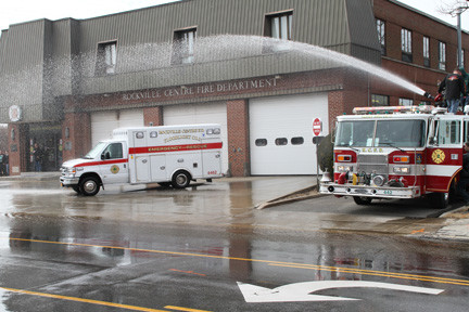 Alert Engine Co. 2 Unit 442 wet down the new ambulance. Alert and Floodlight are both housed together at RVCFD HQ.
