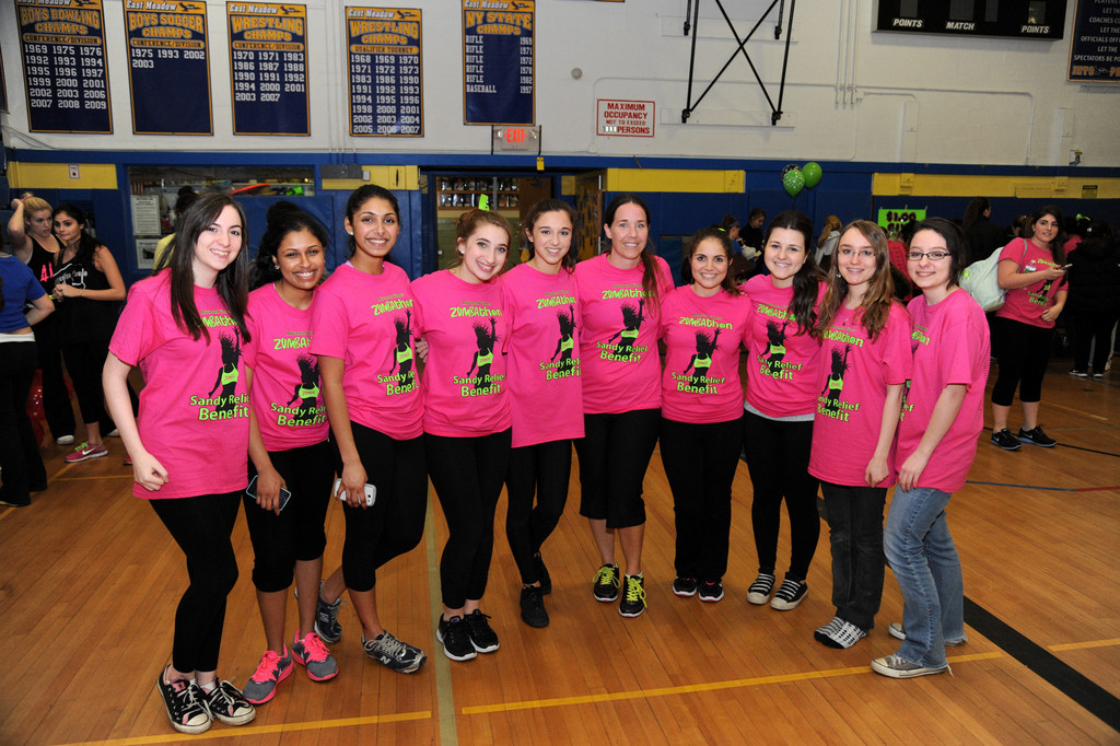 Physical education teacher and event organizer Lisa Guerriero, fifth from right, with students, donned a customized Sandy relief tee shirt.