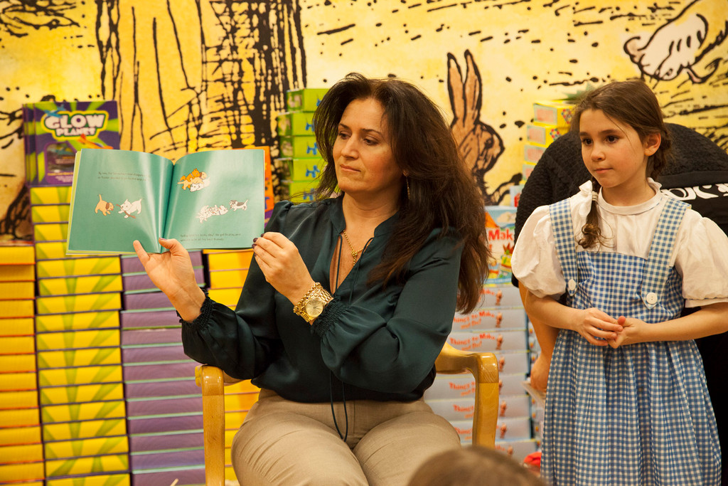 McVey assistant principal Harriet Alfano read a children�s book to students during the party.