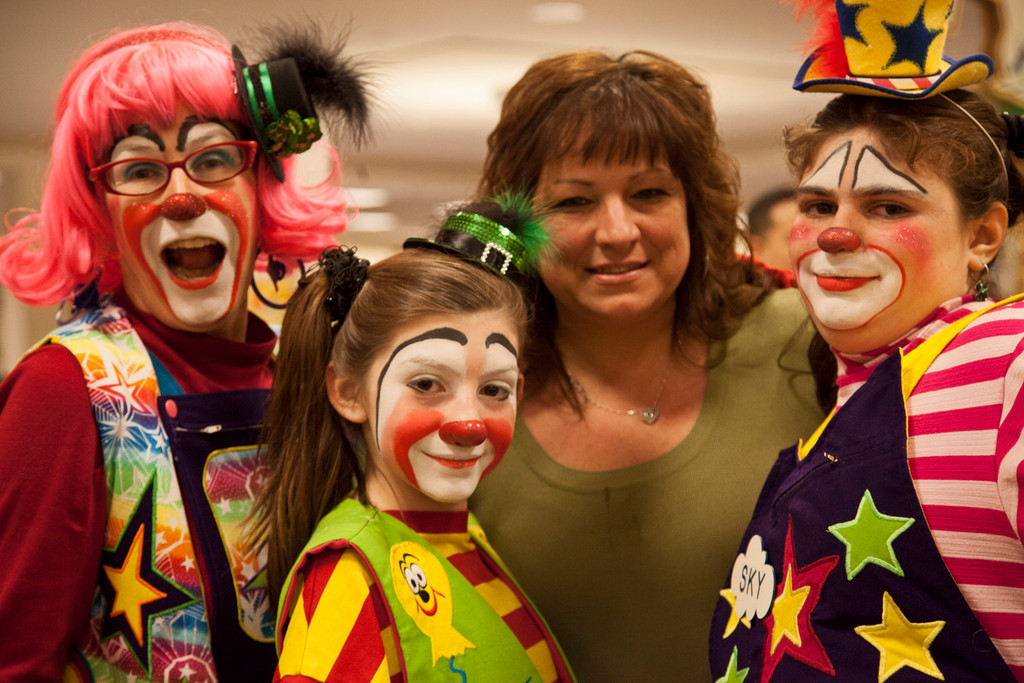 Marion Caruso, in full clown attire, with daughters and fellow clowns Alexis and Skylar, and McVey Elementary School teacher Mrs. Ryder during the Barnes and Noble Reading Party.