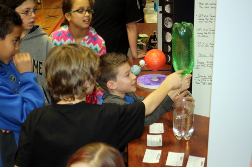Fifth-grader Peter Pagan (right) attracted a crowd as he demonstrated the properties of a tornado at the West End School science fair in Lynbrook.