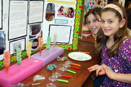 For their experiment at the West End School science fair in Lynbrook, fourth-graders Marianne Lombardo (left) and Gabrielle Grillo compared the properties of salt and sugar crystals.