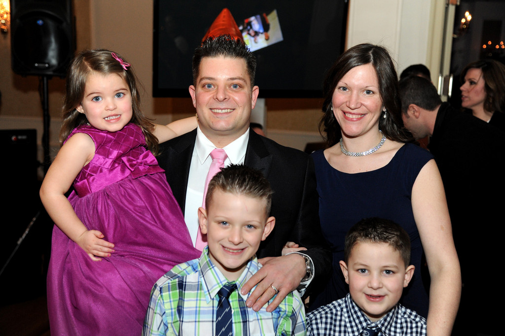 The Ambrosios: Danny and Kelly with their children Kelsey, 3, Christopher, 8, and Connor, 7.