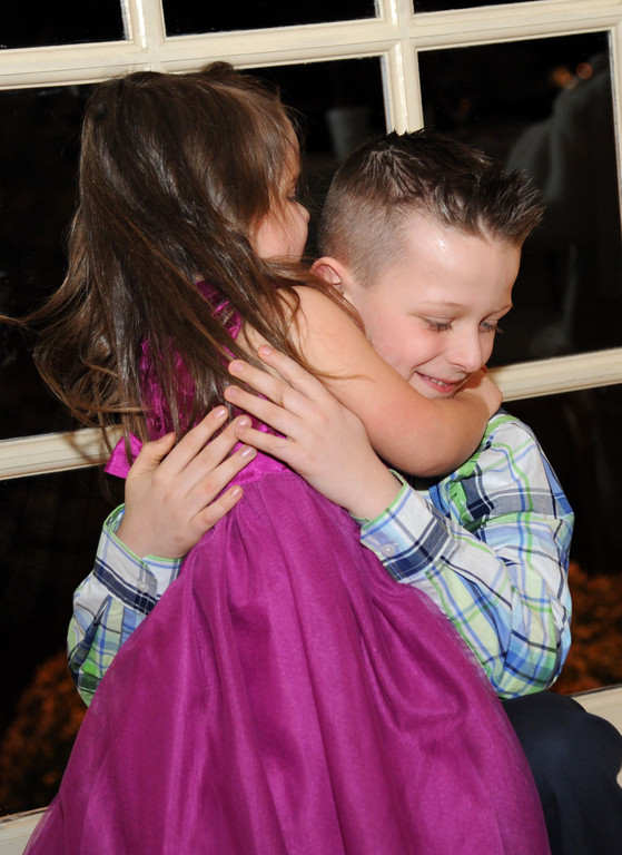 Christopher gave his sister, Kelsey, a hug.
