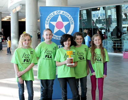 The Smart Cookies won several awards this year. Above, they celebrated a win at the Girl Scout Scrimmage at the Cradle of Aviation Museum in January. The victory allowed the girls to advance to the Long Island Championships.