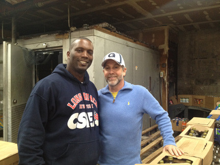 MLK Center board chair James Hodge, left, and C-Town owner Rob Koff on Feb. 12. Koff donated the remainder of the store's inventory to the center.