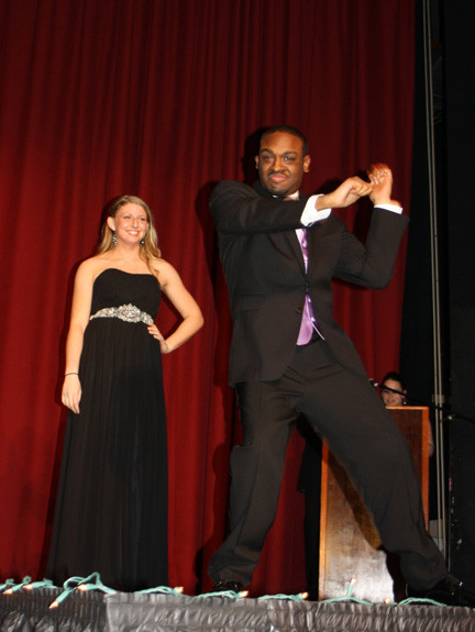 Isaac Williams showed off some of his dance moves as his partner, Hayley Kosiner, looked on.