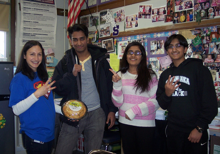 Math teacher Elise Sicherman, left, winner Shahrukh Khan, and runners-up Shafaq Khan and Mohammad Samroz.