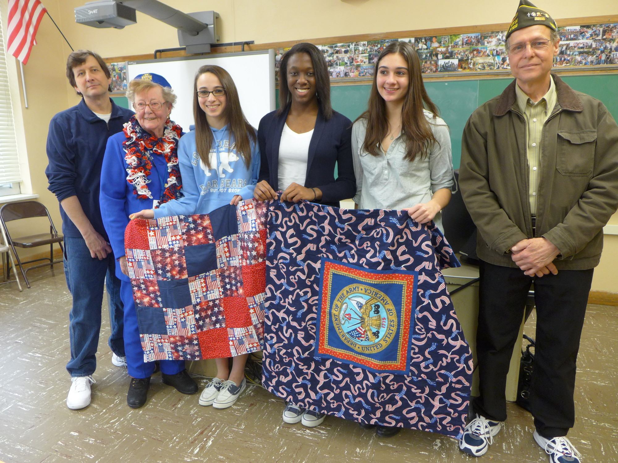 Scott Miller, VFW member and contest judge, Rita Trenz, Chairperson, Voice of Democracy program, Averi Amsterdam, Woodlyn Daniel and Jessica Sammon, essay contest winners, and Raymond Litwin, VFW Post 5199 Commander.