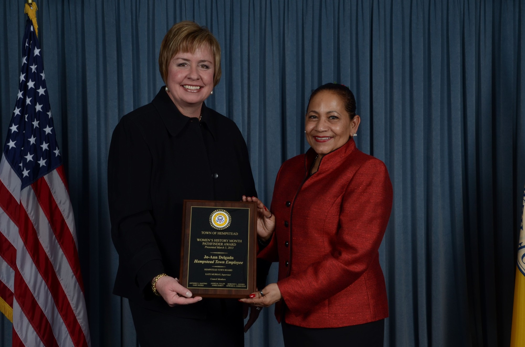 Hempstead Town Supervisor Kate Murray (left) presents the Town of Hempstead Pathfinder Award in the Town Employee Category to Jo-Ann Delgado of Oceanside.