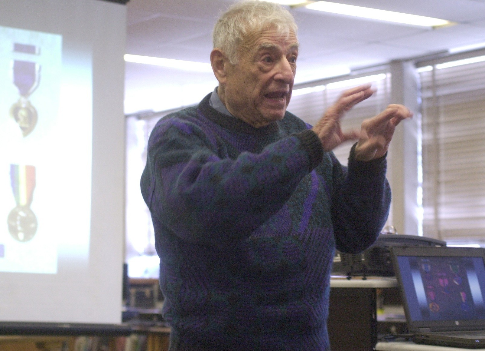 World War II hero Bernard Rader of Freeport delivered a talk about his harrowing experiences in battle at Kennedy High School in Bellmore last Wednesday.