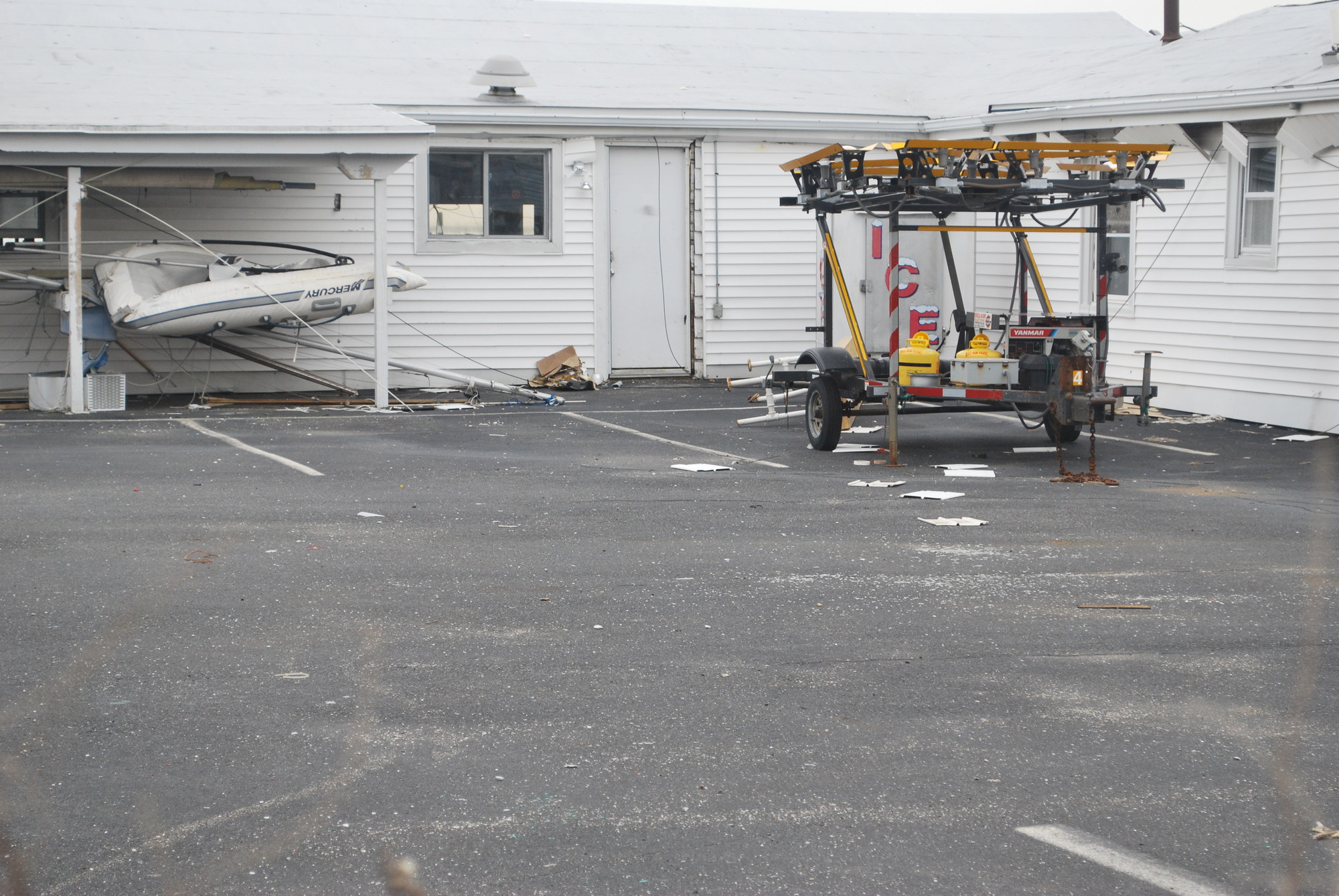 Boat storage areas and the clubhouse building were damaged in Hurricane Sandy.