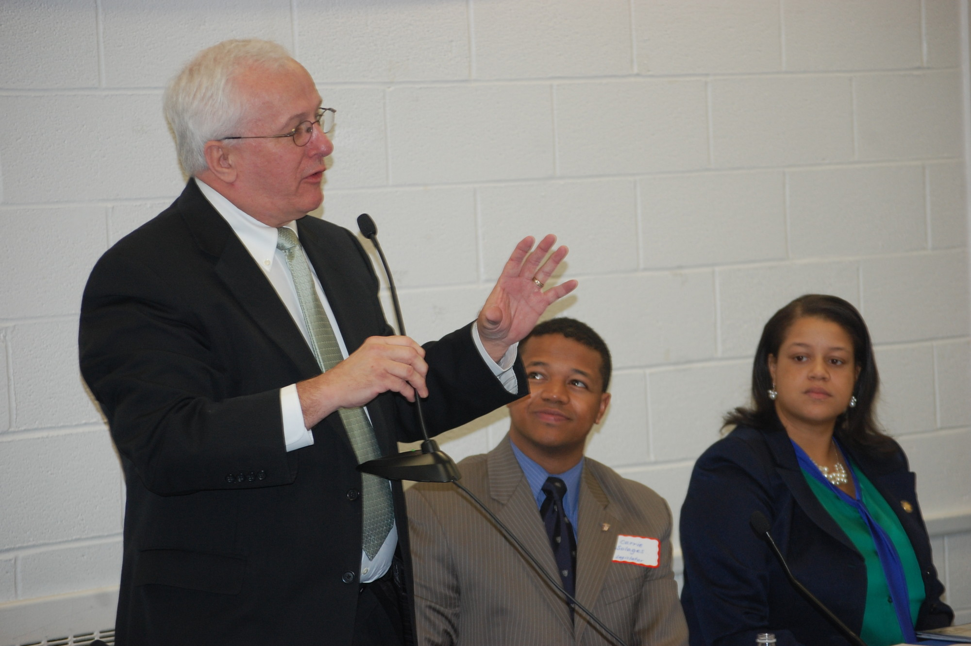 Town Councilman Jim Darcy answers a question as Legislator Carrie Solages and Assemblywoman Michaelle Solages look on.