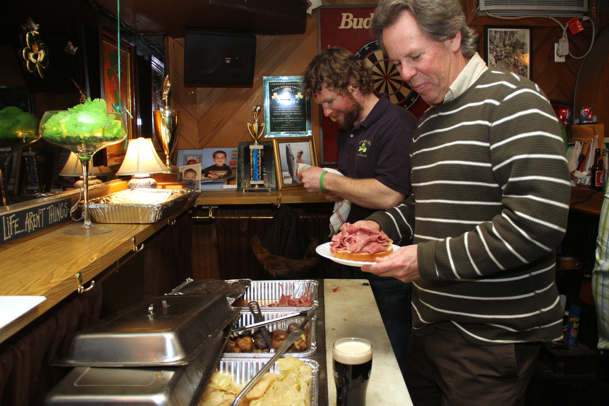 Bridie O's employee Brendan O'Neill, left, kept the food coming for patrons like Steve Collins.