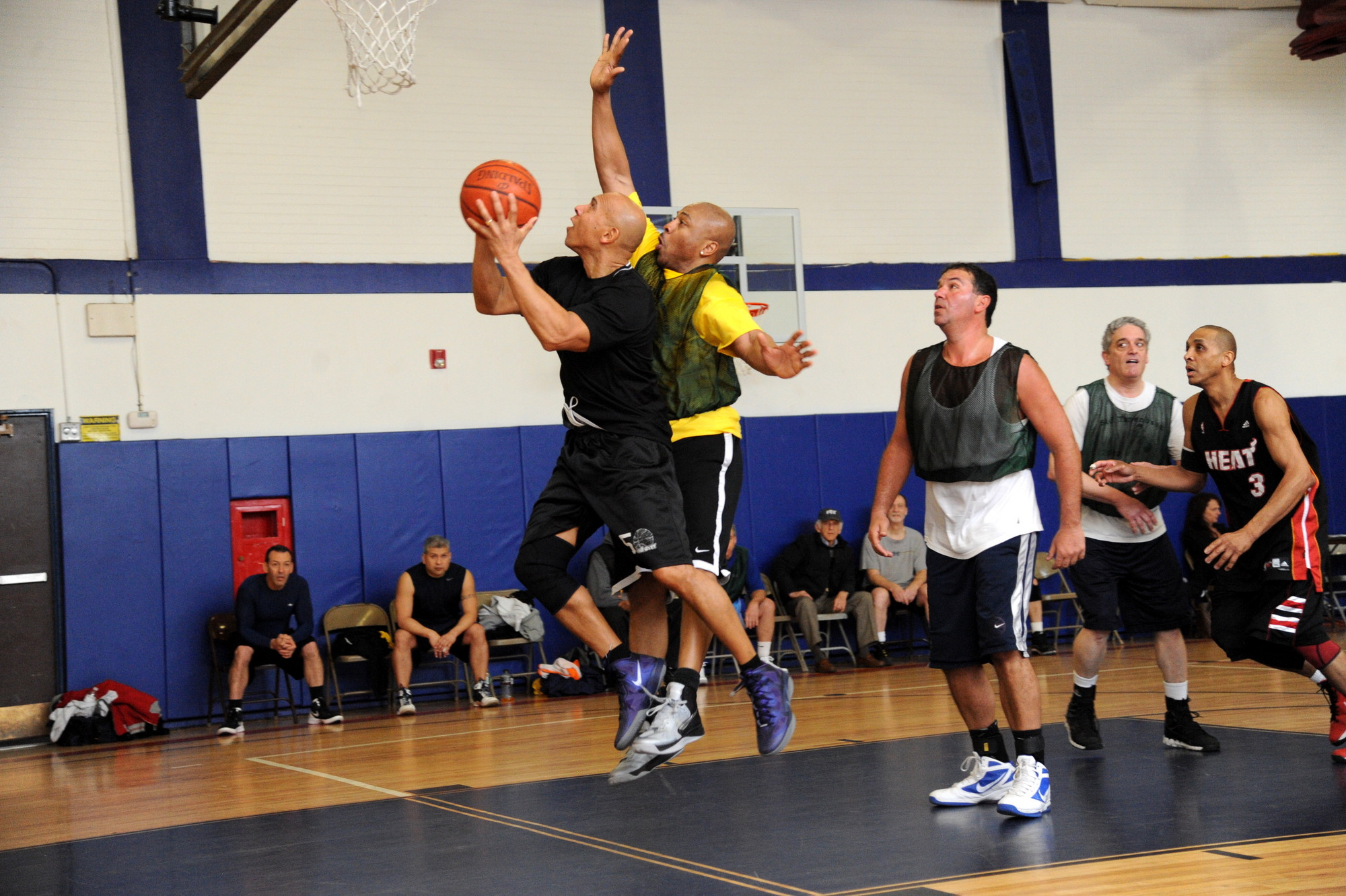 Five Towns Community Chest held its annual Youth Board Basketball Tournament at the Hebrew Academy of the Five Towns and Rockaway's new gym last Sunday.  Vincent Riddock attempted to block Ray Serrano's shot in an adult division game.