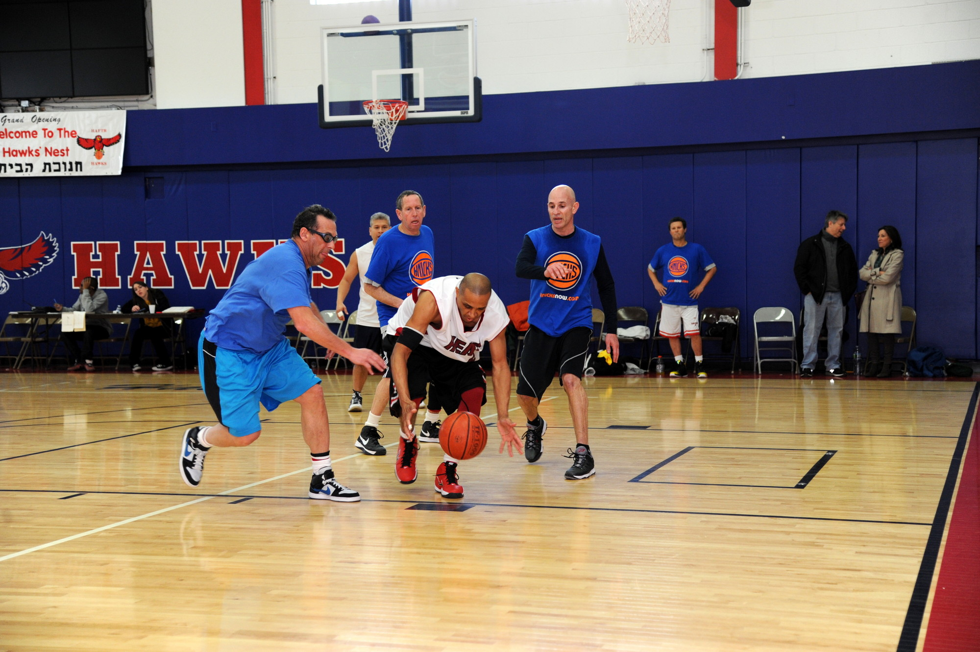 The Five Towns Community Chest Youth Board Basketball Tournament is for a good cause, but that doesn't stop the players from being competitive. At right, in an adult division game, Jim Lusk, left, and James Glenn battled for the ball.
