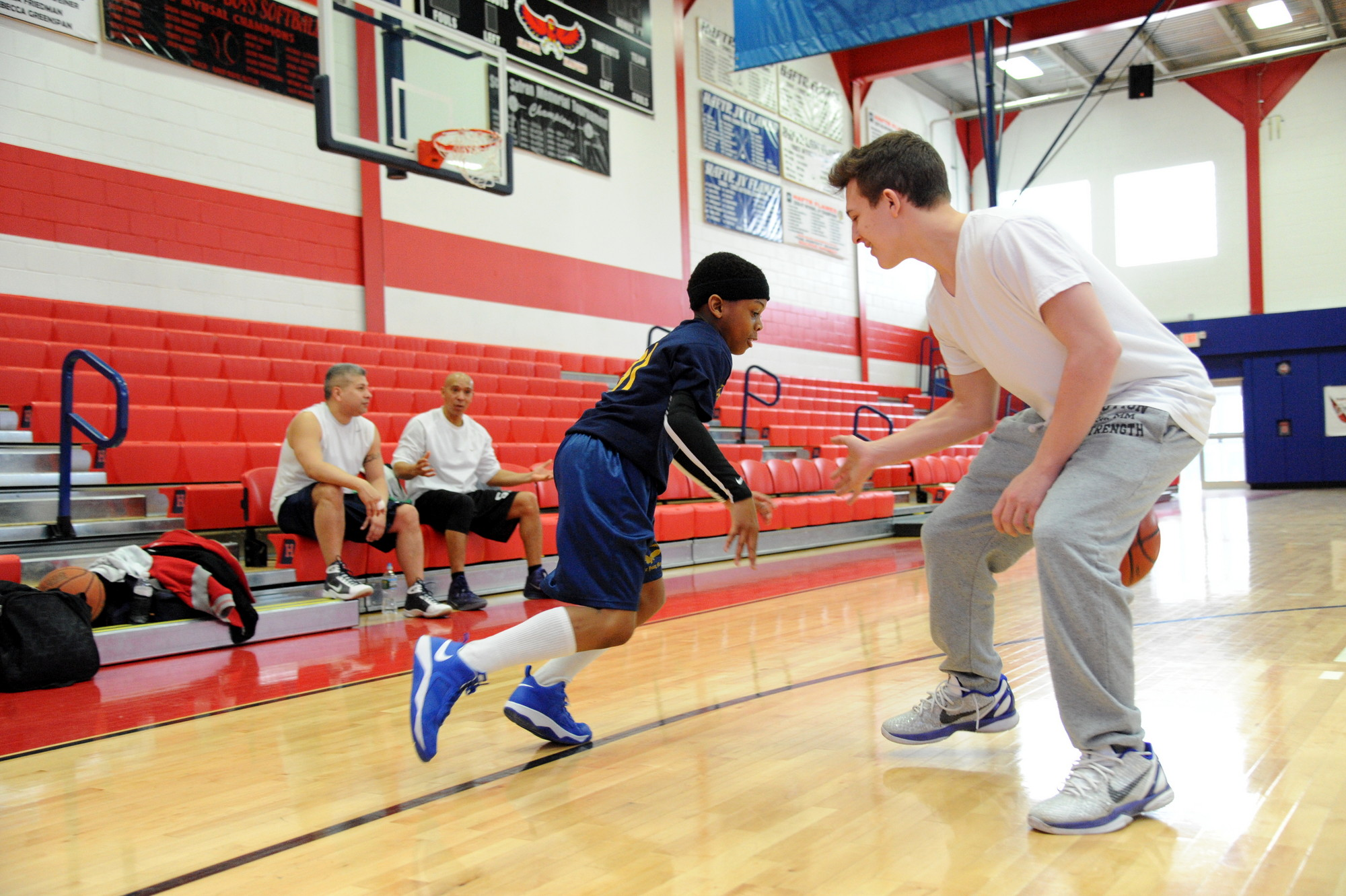 Younger players showed off their skills as Parker Myers dribbled around Josh Netto-Rosen.