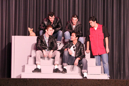 "W.T. Clarke High School recently revived the '50s greaser look with a musical performance of ""Grease."" Above, Riley Walsh, Sean Kalinowski, Andrew Mavrogeorgis, Nick Smith and Alexander Cavanaugh slicked back their hair and flashed some leather.."