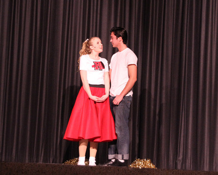 "The play's leads, Brittany Seck and Alexander Cavanaugh, starred as Sandy Olsen and Danny Zuko in ""Grease."""