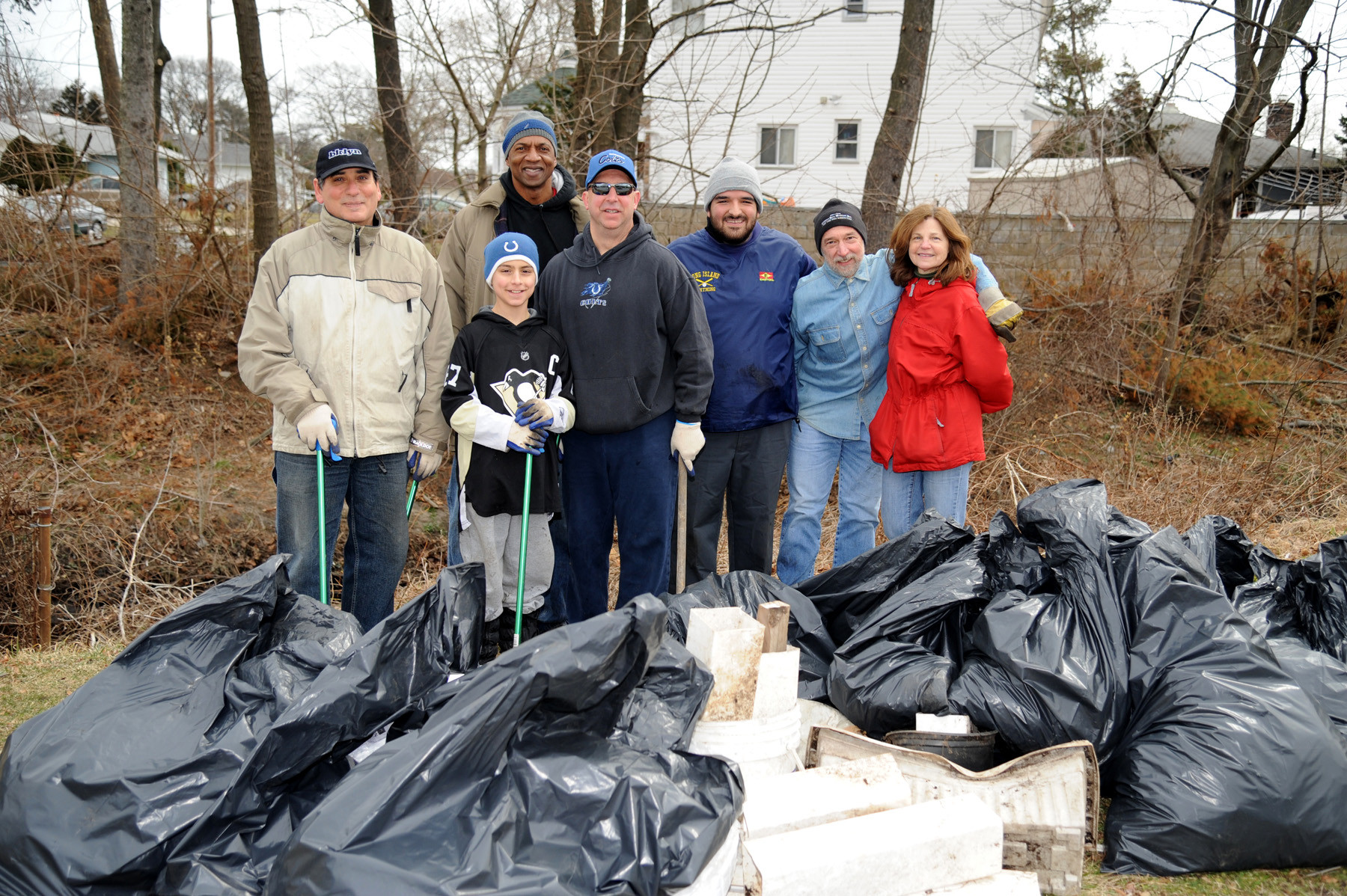 Several Valley Stream residents helped clean up a stream in North Valley Stream last Sunday morning. From Left are Nick Spaventa, Everett Gamory, Brian Milone, Victor Milone, David Sabatino, Bob and Joan Cesario.