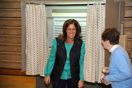 Gina Dimare cast her ballot in the bond referendum.