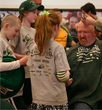 Last year, many people turned out to have their heads shaved. Pictured here at the 2012 event are, from left, are Brady, Shannon, Casey and John Bender.