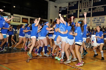 Blue celebrated its win at tug of war.