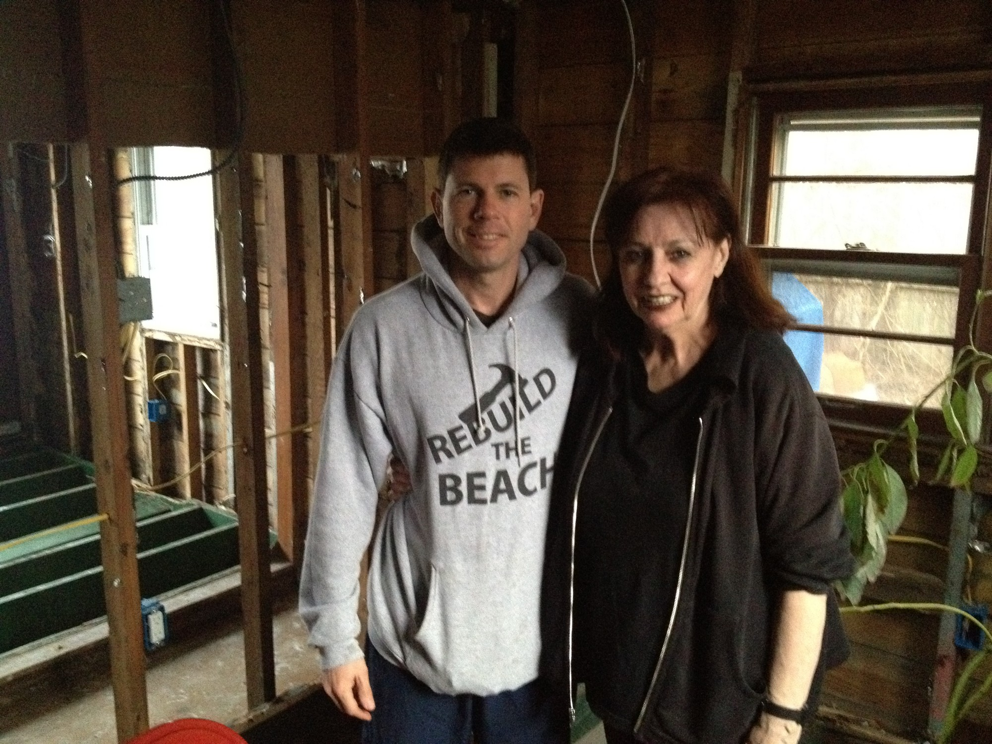 Bryan Murphy, left, the founder of Sandy Help LB, with Marian Freedman in what used to be her living room.