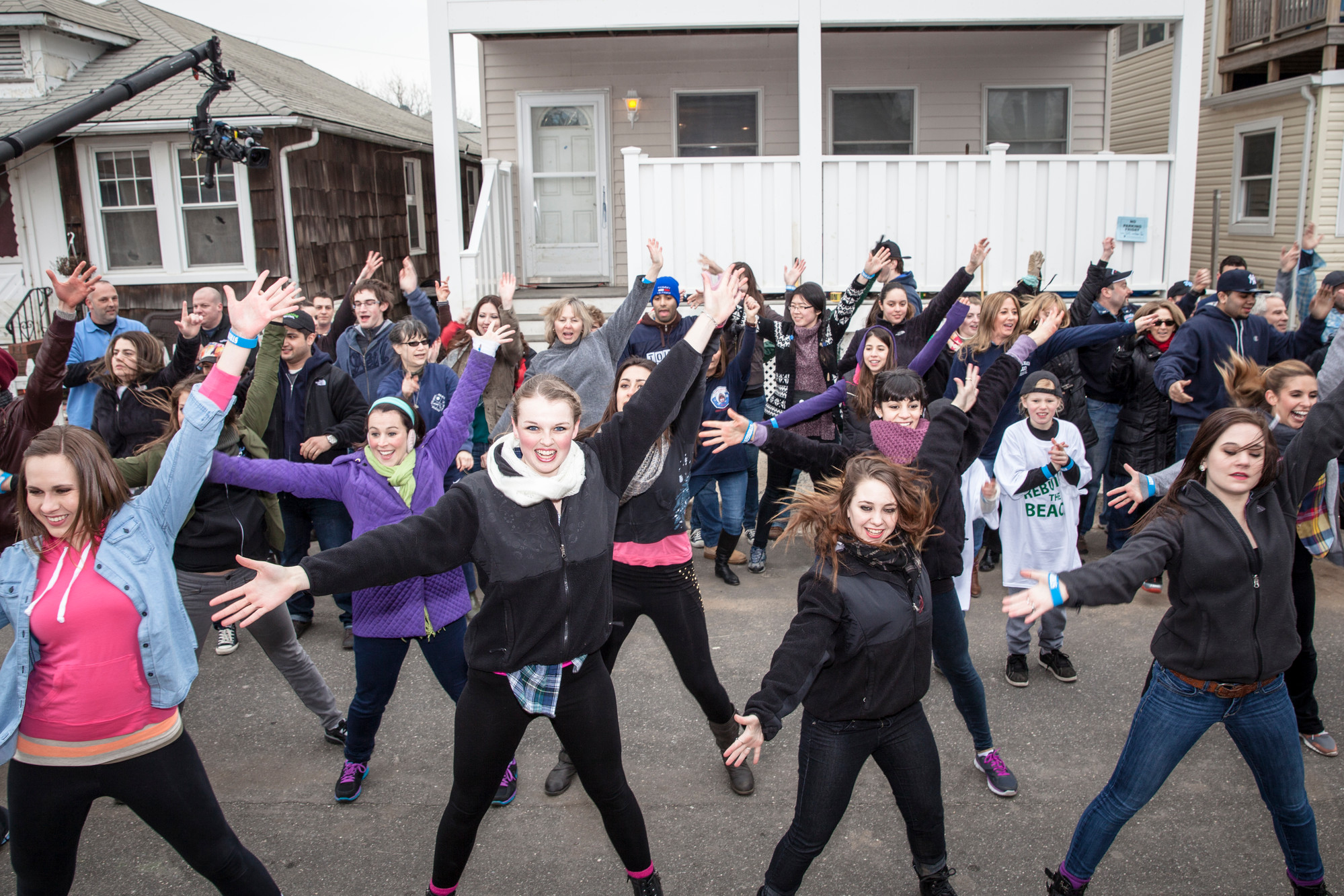 The flash mob performs outside of the Enrights' house.