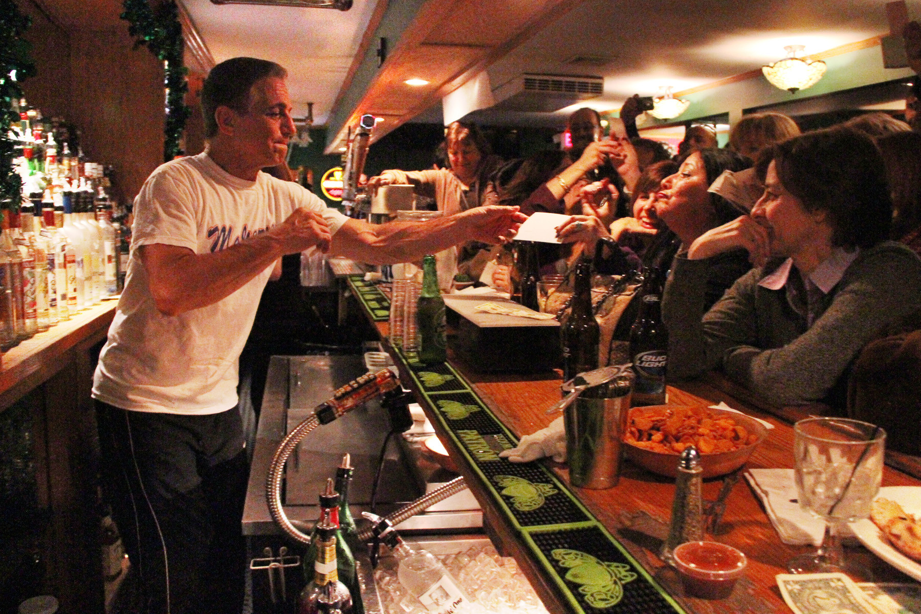 tony danza serves drinks at Connolly's Station in Malverne on March 14 at a fundraising event for students at the Malverne Middle School.