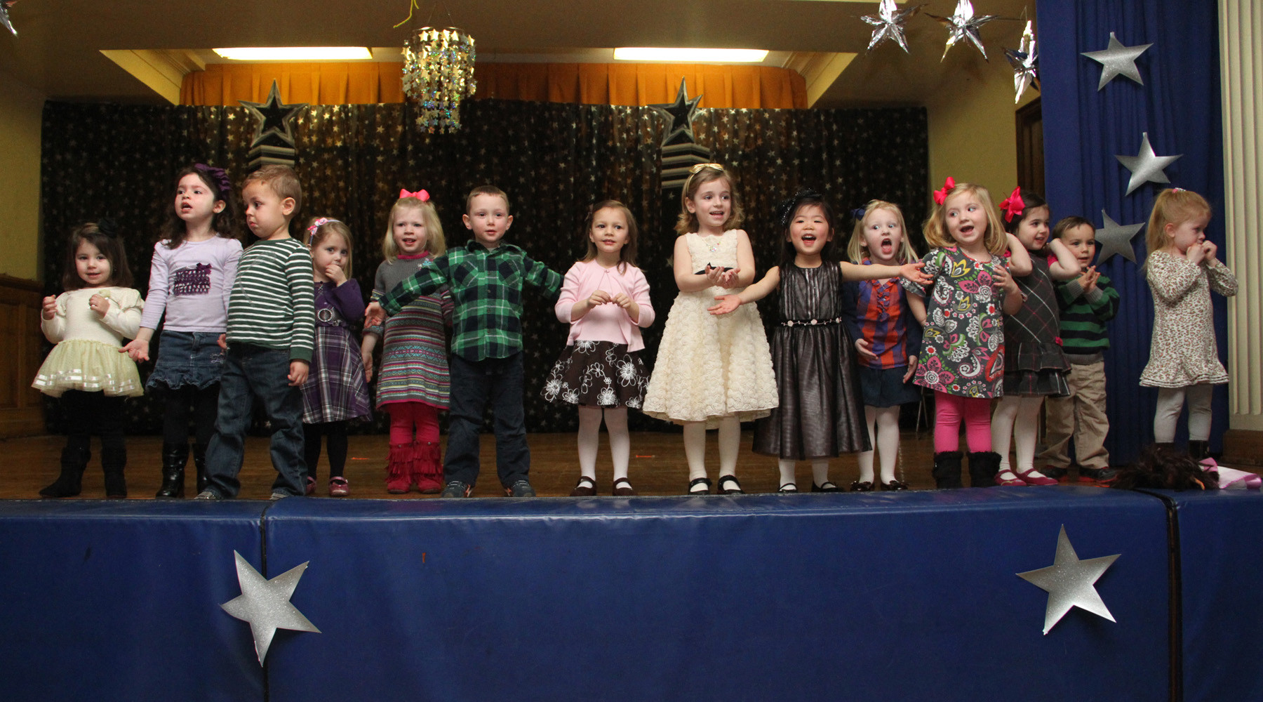 "The Our Lady of Lourdes Nursery class performs ""He's Got the Whole World in His Hand."""