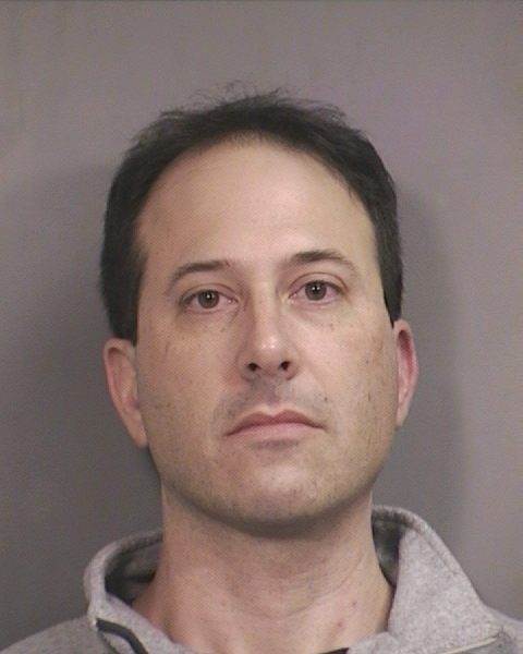 Douglas Dukofsky was arrested after a patient claimed he forcibly touched her during an exam. He denies the charges.