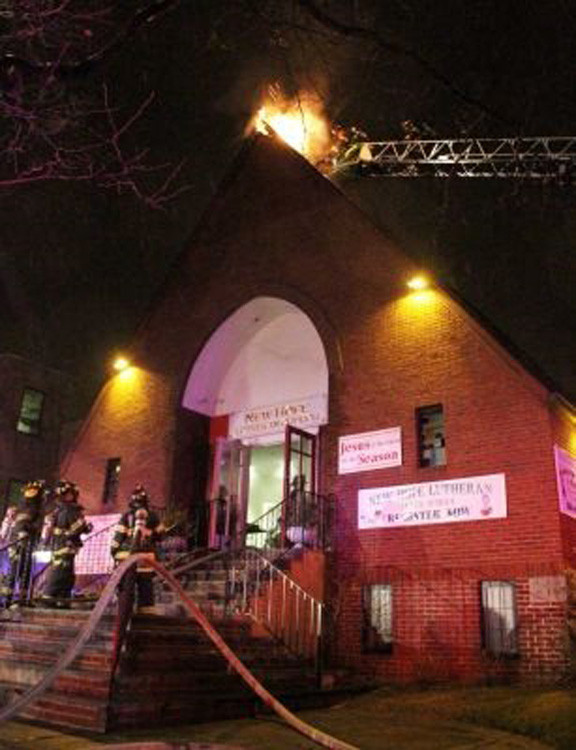 Firefighters face a roof fire at the New Hope Church on Oliver Avenue on February 8, 2012