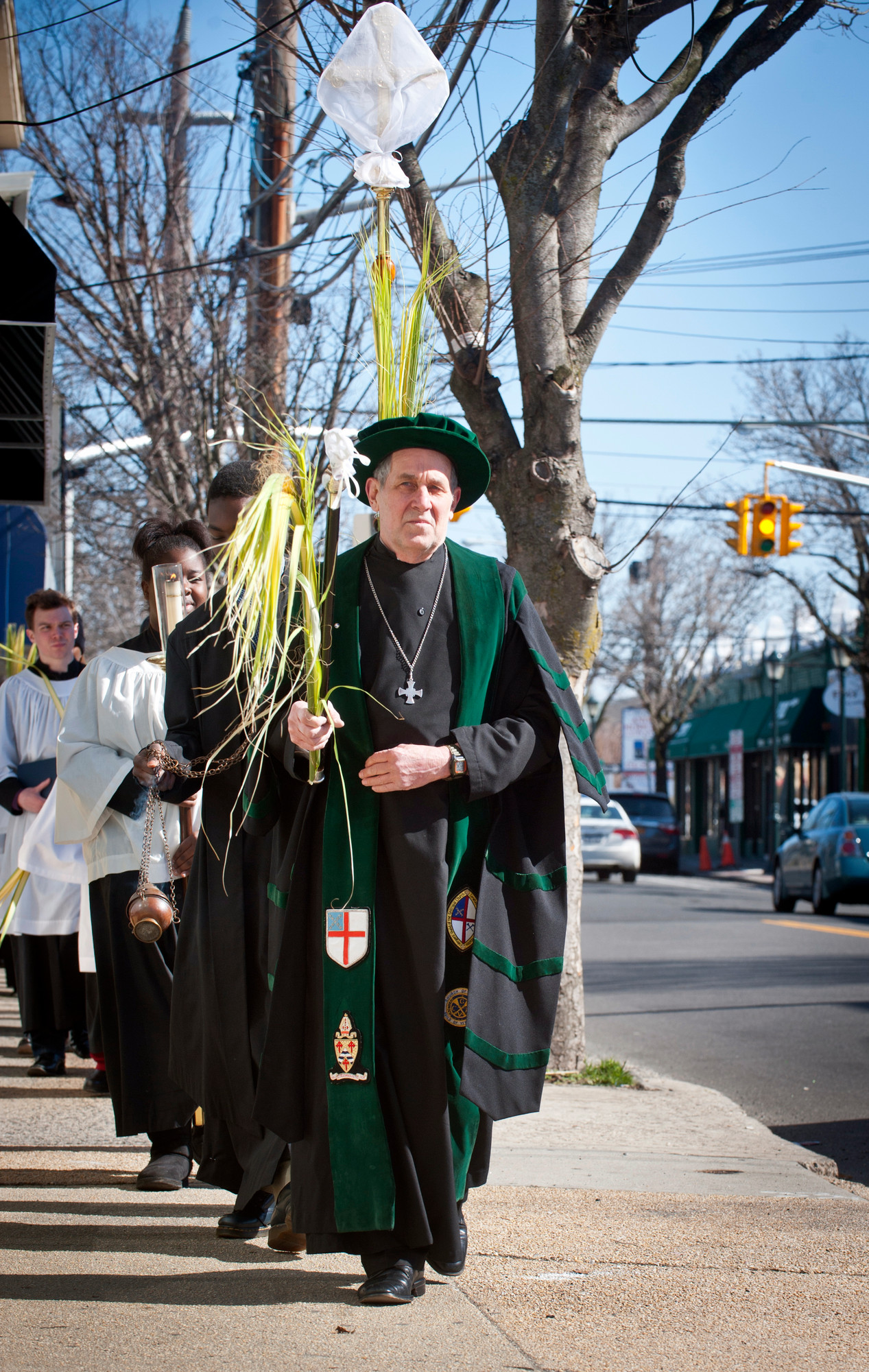 Trinity-St. John's Church in Hewlett held its annual Palm Sunday procession on March 24. Church verger Richard Walther led the march on Broadway.
