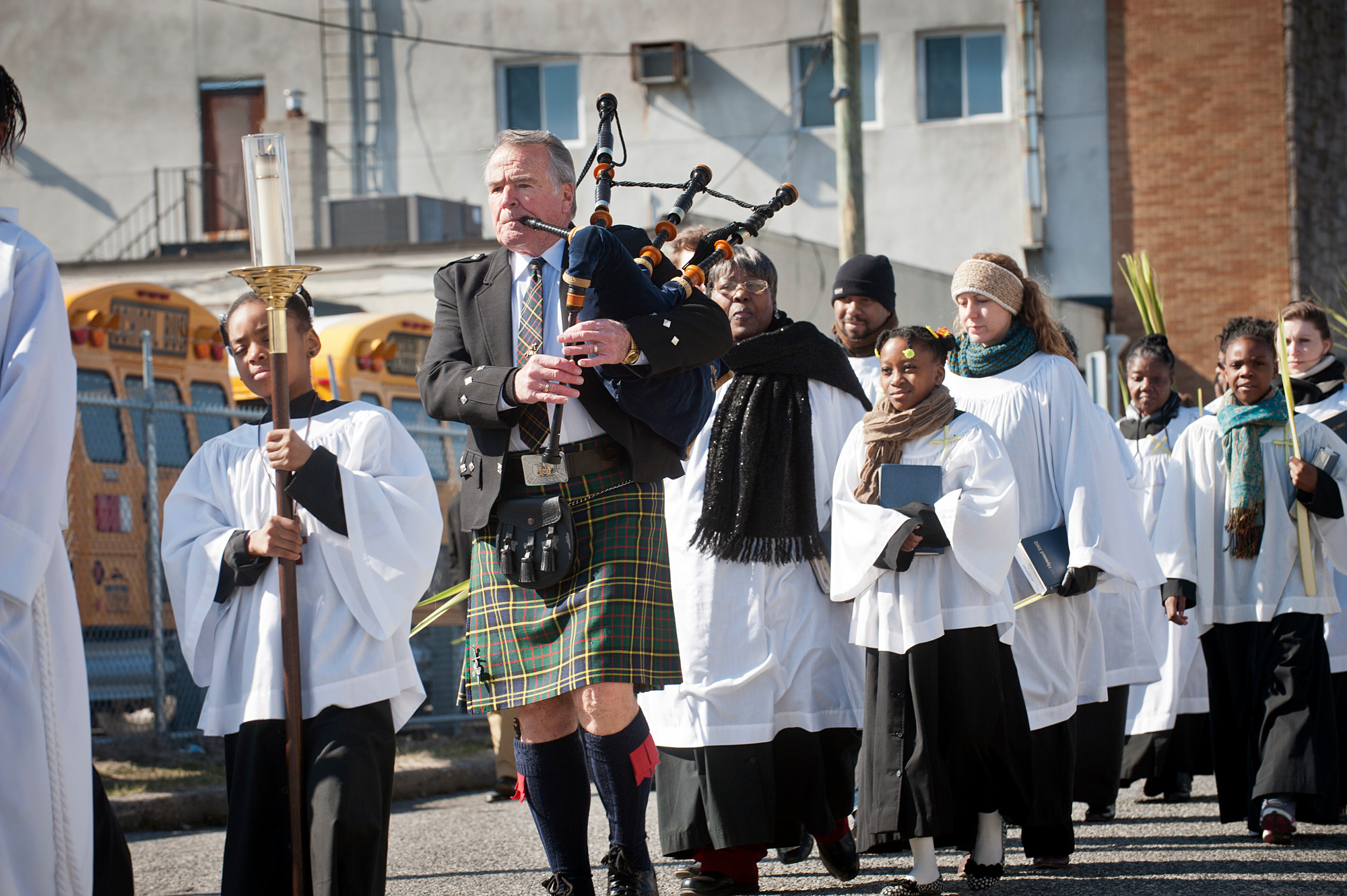 Bagpiper Jim Noone,of the Wantagh Bag Pipe Band, played the Highland Bagpipe during the Palm Sunday procession.