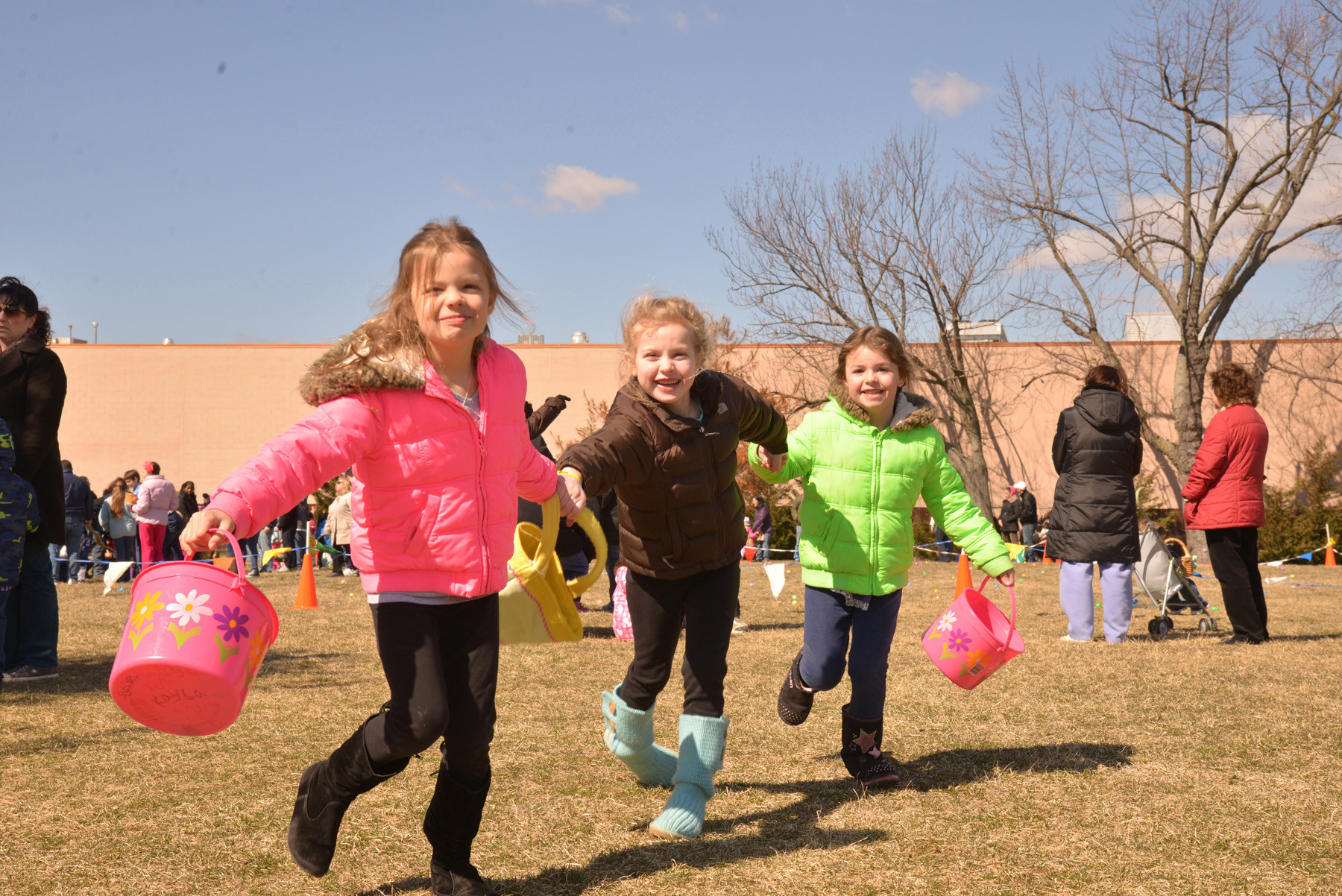 Kayla Bregel 8, Tara Steiger 6, and Lauren Bregel, 5, got off to a fast start during the Easter egg hunt at Schoolhouse Green in Oceanside last Saturday. Story, more pictures, page 11.