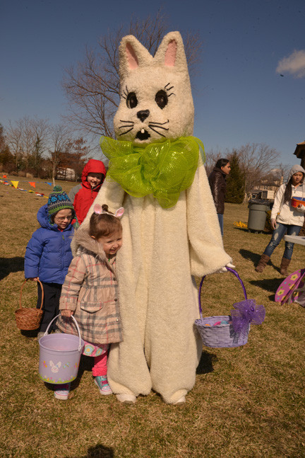 Oceanside resident Adriana Aulette  gives the Easter Bunny a hug at the schoolhouse grees in Oceanside.