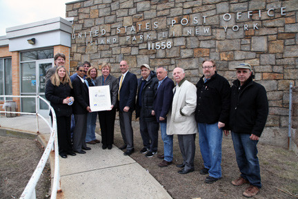 Hempstead Town Supervisor Kate Murray (6th left) presents an official Town of Hempstead Citation in fitting recognition of the grand re-opening ribbon cutting ceremony of the Island Park Post Office located at 367 Long Beach Road in Island Park.  Pictured also are Postmaster Joan Rivera of Brooklyn; Postal Worker Sean Shaueler of Island Park, Island Park Village Mayor James Ruzicka, Island Park Village Deputy Mayor Stephen D'Esposito, Island Park Village Trustee Irene Naudis, Island Park Chamber of Commerce President Glenn Ingoglia, Michael Scully of Island Park, Joe Ponte of Long Beach, Bobby Romano of Island Park, Karen Varrone of Oceanside, and Zoning Board Chair Michael McGinity of Island Park.