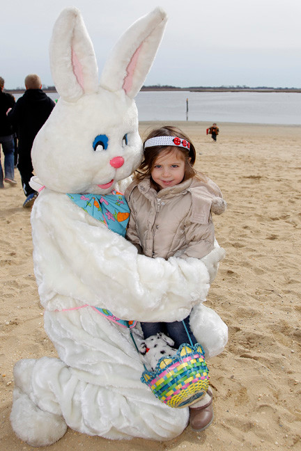 FOur-year-old Emma Cooney, from East Rockaway, met the Easter bunny after the egg hunt.