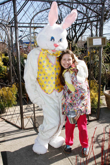 Ana Markovina, 8, of Old Westbury, didn't miss her opportunity to pose with the Easter Bunny.