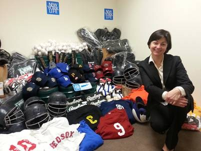 New York Life Agent Maya Bensen spearheaded the company's collection of thousands of dollars' worth of baseball equipment as part of its partnership with the nonprofit Pitch In For Baseball.
