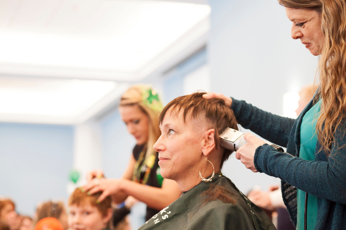 Cancer survivor Karen Jahn was the only woman to have her head shaved.